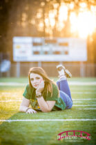 Charlotte-North-Carolina-Senior-Potrait-Photography-with-Riley-on-football-field