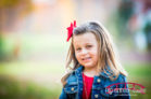 Backyard-fall-family-photos-with-two-little-girls-in-red