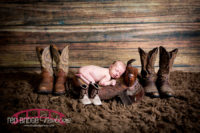 Lucy's-raleigh-north-carolina-newborn-studio-session-with-a-horse-saddle-prop