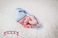 Braxton's-Raleigh-NC-Newborn-Portrait-Session-with-a-travel-theme