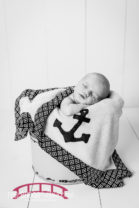 Wade-and-his-big-brother-dog-with-heirloom-props-newborn-photographs