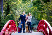 Family-fall-portraits-in-the-garden-with-a-dog-in-durham's-Duke-Gardens