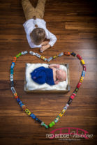 Benjamin-and-his-big-brother-in-home-Holly-Springs-Newborn-Photographer