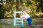 Teal-and-yellow-themed-cake-smash-in-raleigh-baby-studio