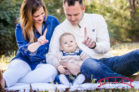 Raleigh-family-portraits-at-historic-park-on-a-bright-day