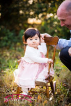 gold-and-pink-themed-studio-cake-smash-first-birthday-photography-in-raleigh