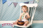 boy-cake-smash-session-in-studio-for-first-birthday