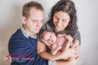 newborn-girl-in-newborn-studio-with-purple-and-christmas-and-raleigh-wedding-videographer