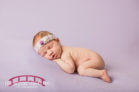 newborn-girl-in-newborn-studio-with-purple-and-christmas-and-raleigh-wedding-videographer