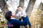Early-spring-family-pictures-at-Oakview-park-with-teal-and-blue-and-little-boy-in-suspenders